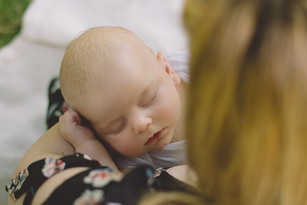 looking over shoulder on sleeping newborn baby south wales