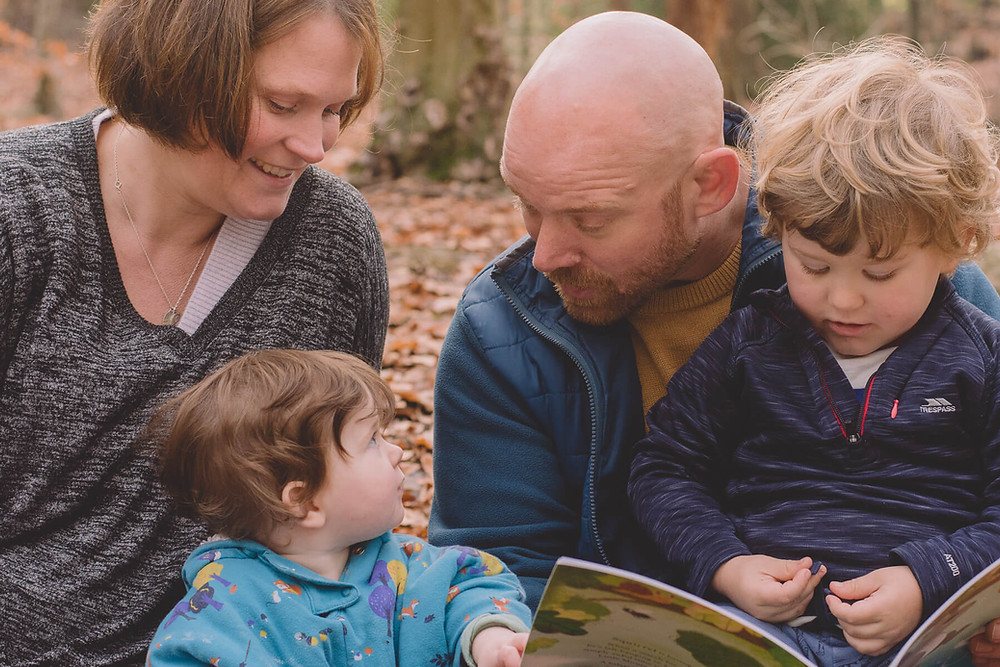 family photoshoot reading together autumn forest south wales
