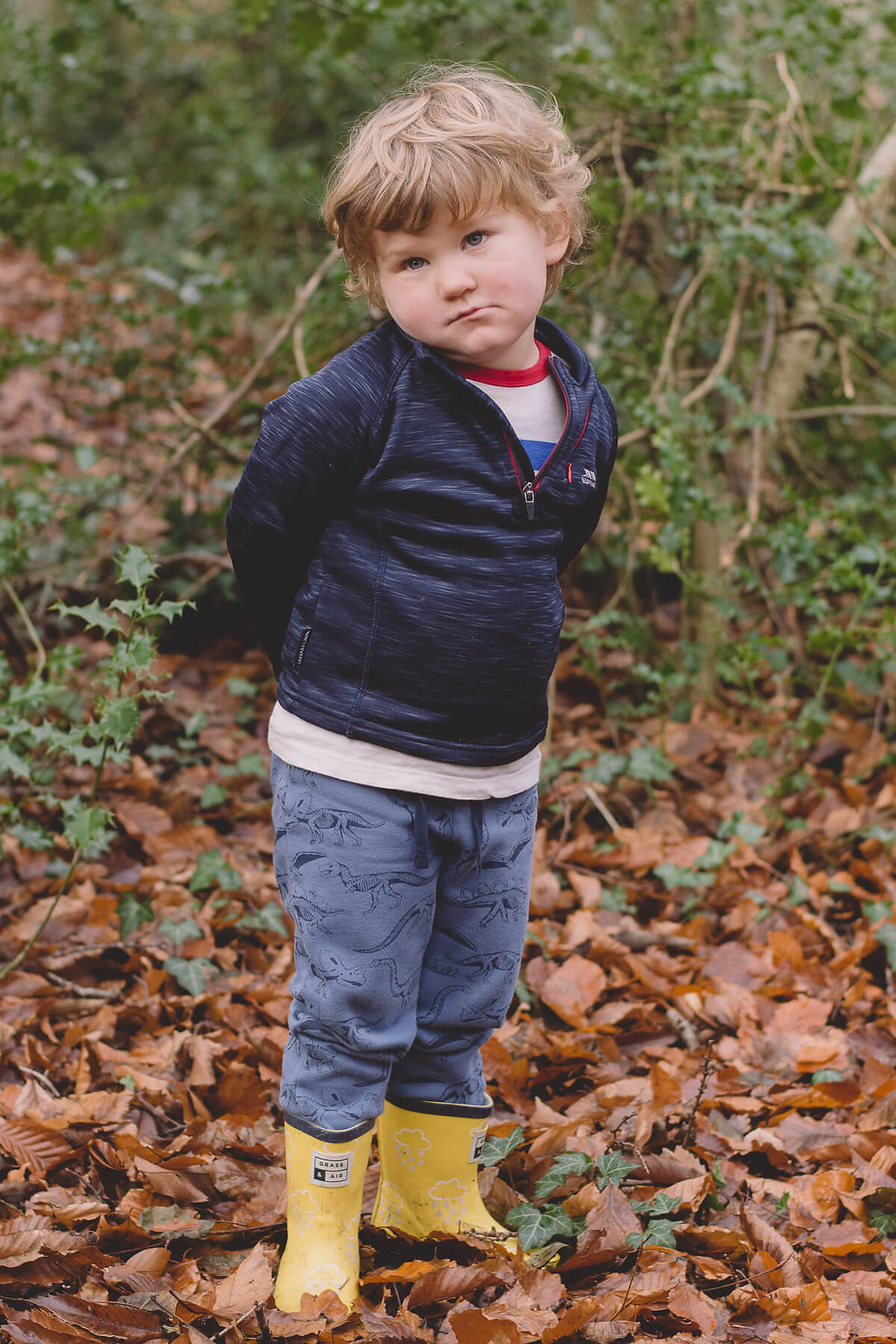 family photoshoot south wales boy in forest looking serious