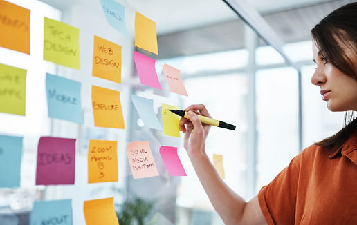 Female organizing project management with sticky notes