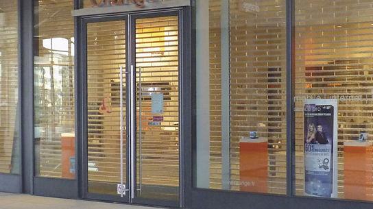 Installation grille métallique magasin à annemasse