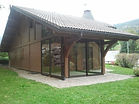Installation d'une véranda su mesure avec toiture en tuiles proche d'Evian
