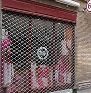 Grille protection magasin à Thonon les Bains