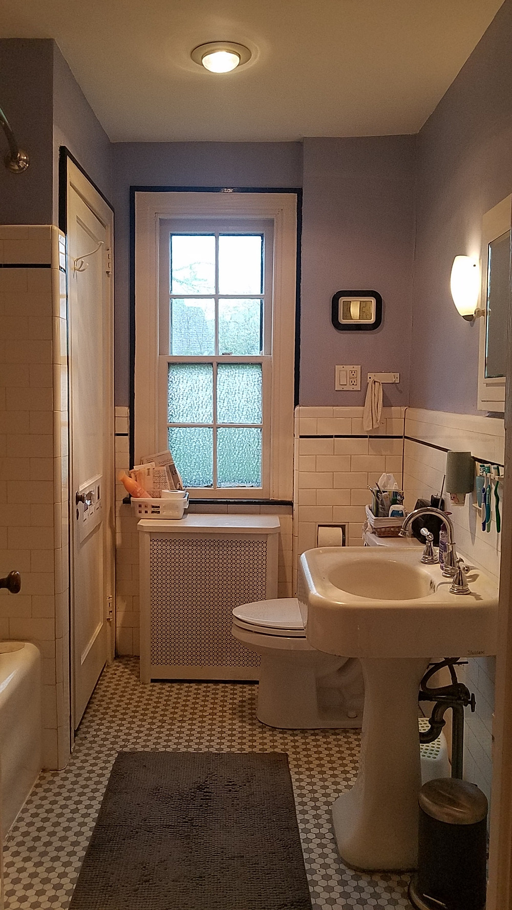 David W. Feldman's bathroom features subway tiles, a pedestal sink and a built-in bathtub, all changes that were made after the 1918 pandemic in an effort to minimize germs. (David W. Feldman)
