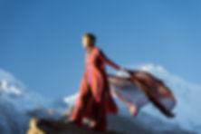 Canva - Woman in Orange Dress Standing o