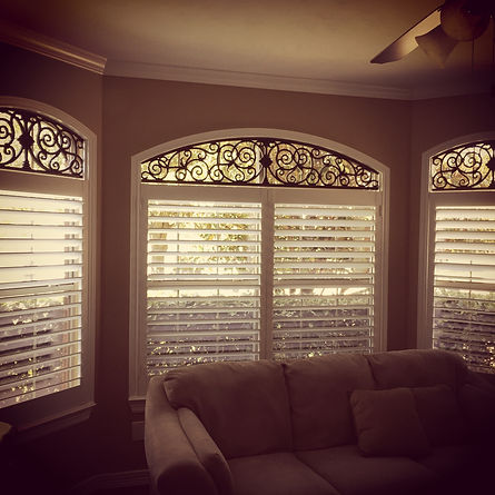 Custom Shutters with Faux Iron Arches