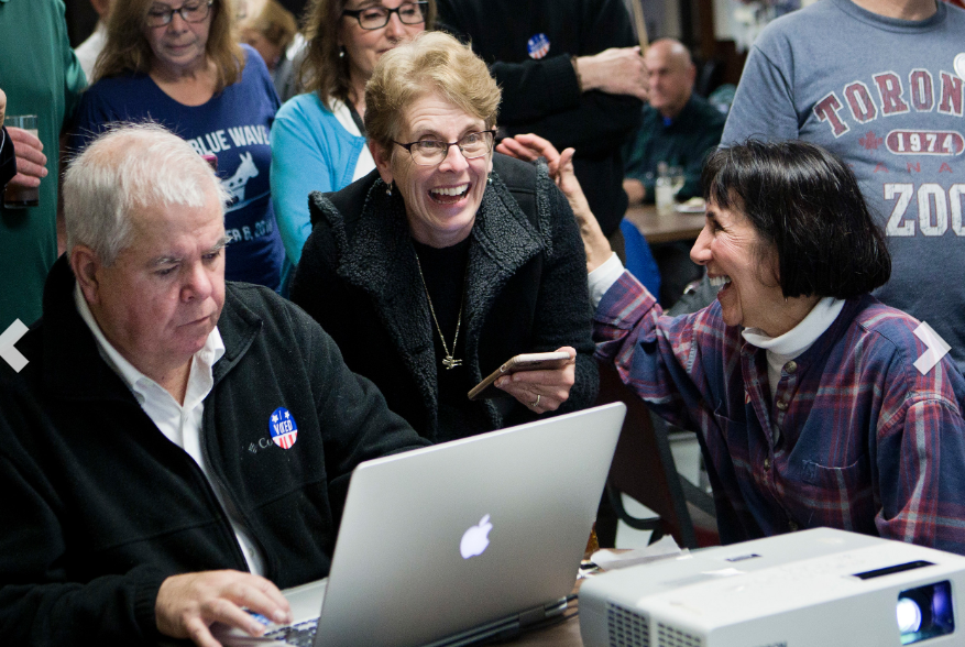 House District 72 candidate Terri-Denise Cortvriend, a Democrat, reacts as she watches the ballots tallied in her favor at the Portsmouth Portuguese American Citizens Club Tuesday night. She defeated incumbent Kenneth Mendonca. At left is Sen. James Seveney, who won another term in District 11. At right is Sen. Seveney's wife, Valerie. JULIE FURTADO
