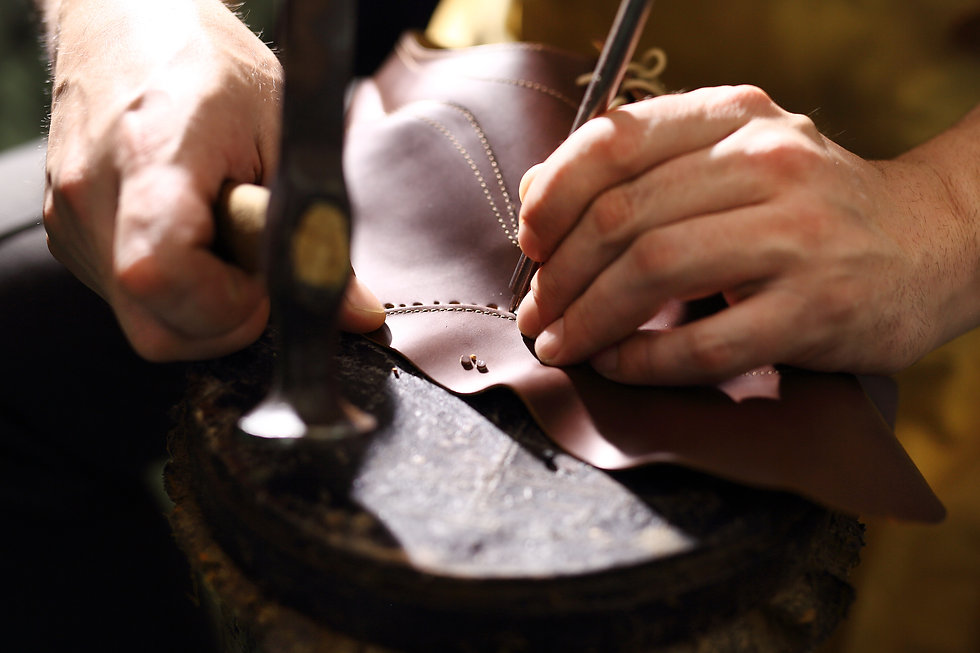 Grain leather. Shoemaker performs shoes