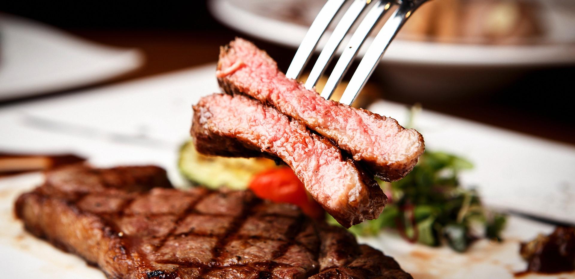 Sirloin steak on plate.jpg