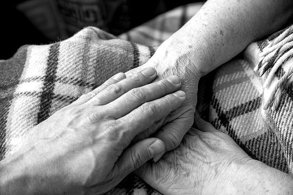 male-hand-old-woman-hands-son-is-taking-