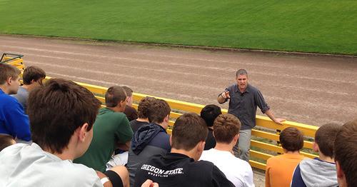 TJ Hoisington speaking to h.s. football team
