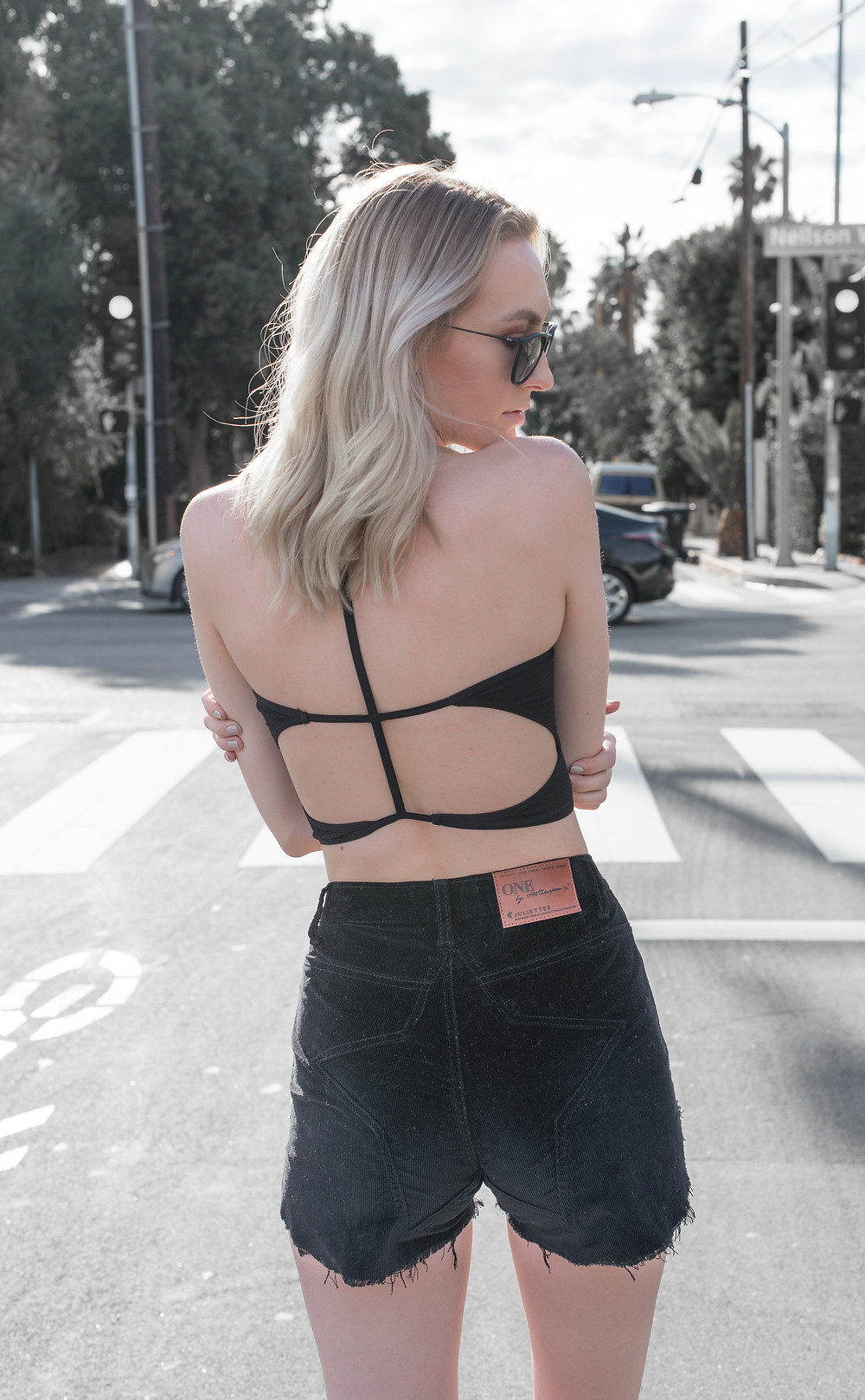 Blonde girl wearing a crop top from free people