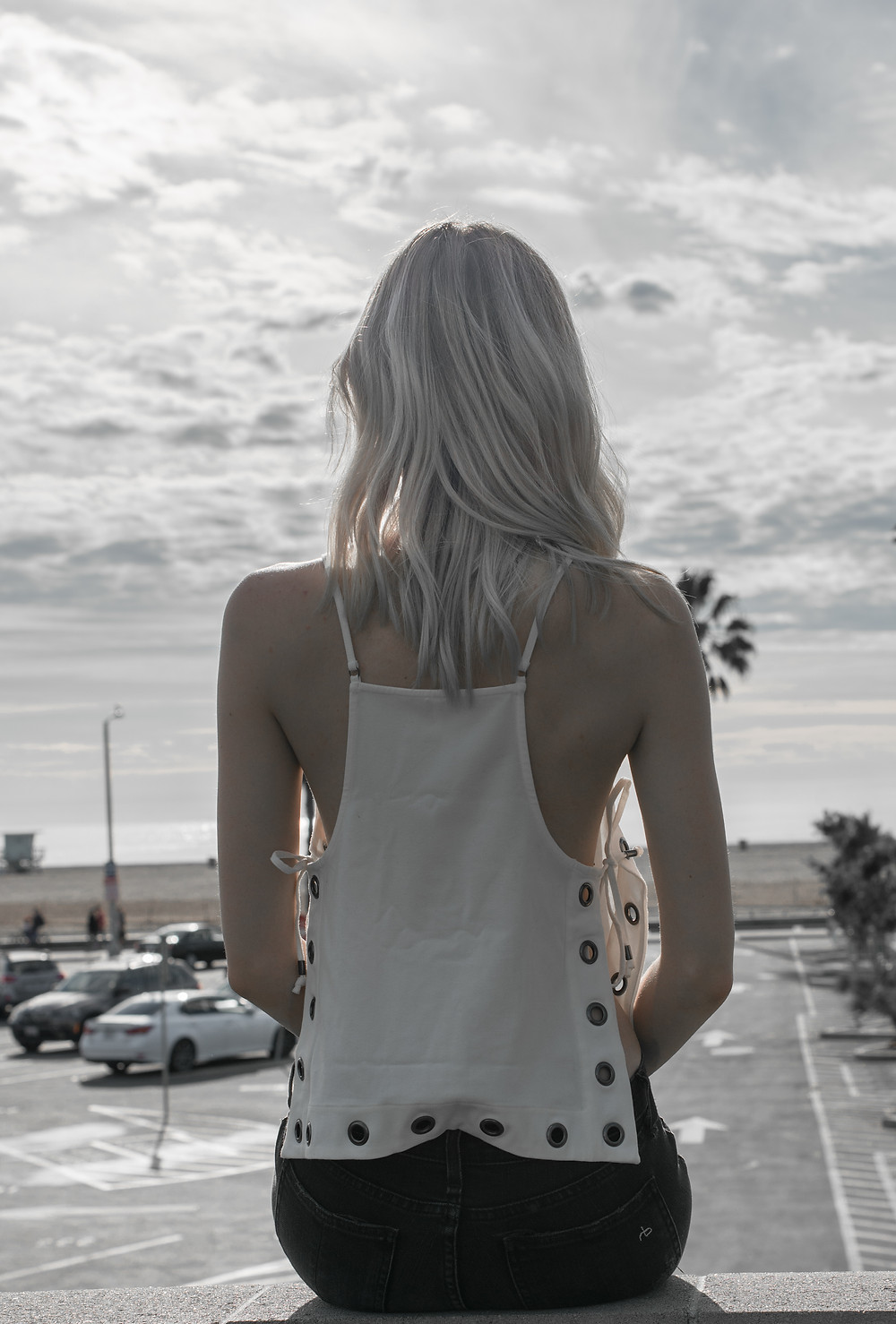 girl looking out at the ocean