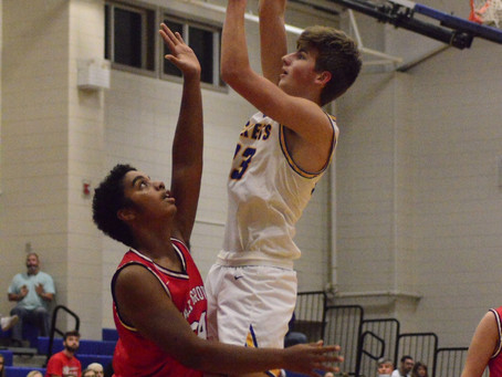 Curry and Dora split in varsity basketball action
