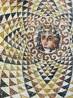 an ancient mosaic at the corinth archaeological museum