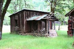 Old Smoke House Behind River Lodge