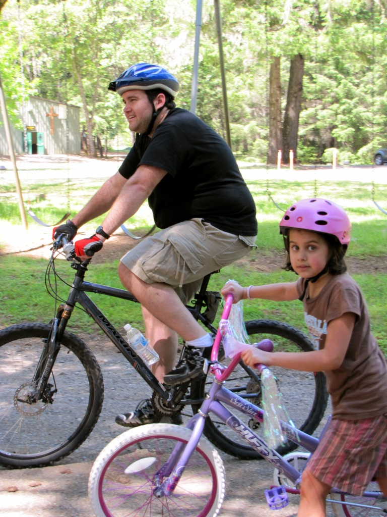 Father and Daughter Bikes at Camp