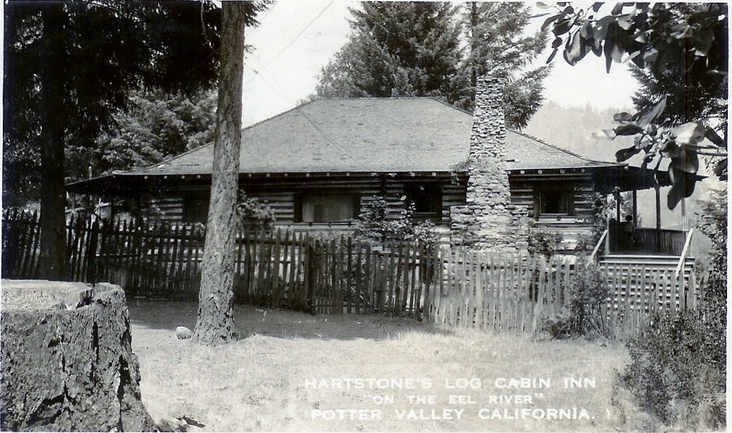 Orginal Hartstone Log Cabin Inn in place of where current flag pole is now