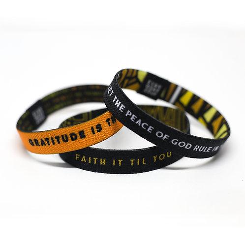 black yellow christian wristpack
