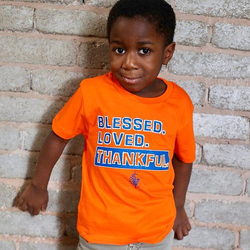 child's bright orange bible slogan t-shirt blessed loved thankful