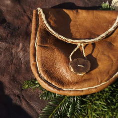 Spruce bark tanned deerskin bag with buckskin details and gorse wood button