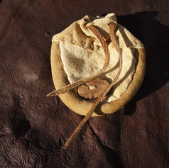 Buckskin pouch with gorse wood button