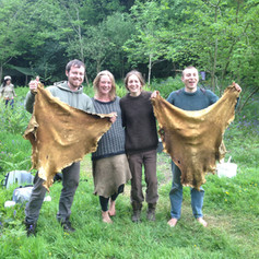 Two completed buckskins... and their tanners