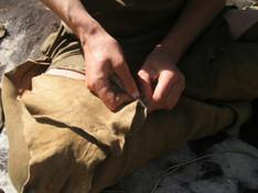 Sewing buckskin with a bone awl