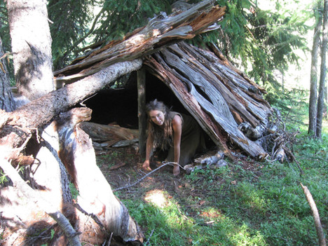 A shelter of Larch slabs - home for 3 snuggled in the buffalo robes and felted blankets