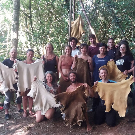 Hide camp Devon 2018 - a whole flock of newly fledged hide tanners display their well-earned beautiful buckskins