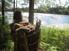 Walking in Sweden - a dogwood and rawhide deerskin pack basket carries our belongings