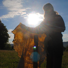 A student on one of our buckskin camps rises early to catch the morning sunshine