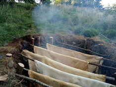 Smoking hides in the pit smoker