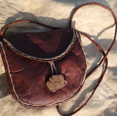 Bark tanned deerskin back with gorse button and buckskin trim