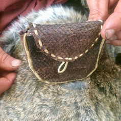The weekend's completion. This participant made a beautiful salmon skin bag from his fish leather, and some deerskin buckskin. Plus a lovely soft rabbit fur hide.
