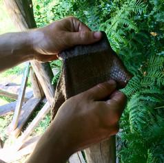 Softening a bark tanned salmon skin