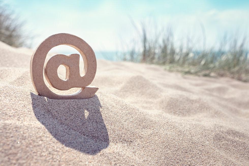 e-mail-symbol-at-the-beach-RE4LZPH.jpg