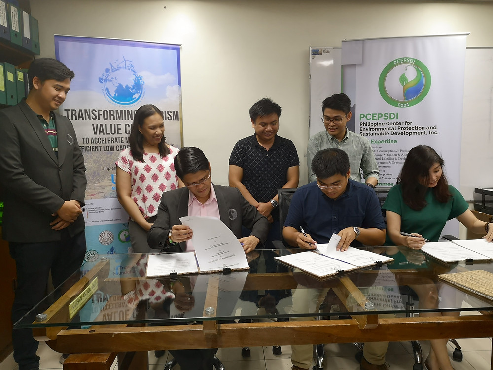 Signing from Left to Right, Executive Director for PCEPSDI, Mr. June Alvarez; General Manager for Trakaro: Sustainable Travels, Mr. Paul Galacan; and COO of Kezar Innovations Pte. Ltd., Ms. Kat Chua.
