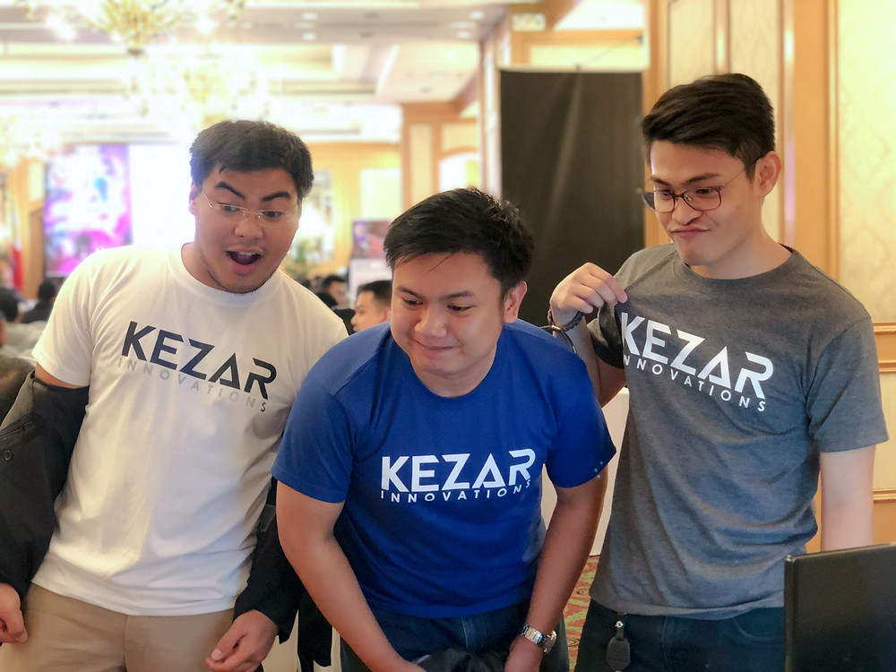 CFO, Paul Galacan, CEO, Edward Solicito, and CMO, Sean Lacar proudly represents their Kezar merchandise during the networking sessions.