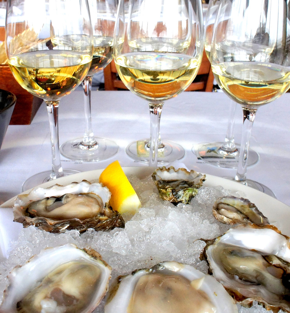 """You are cordially invited… August 7, 2015 Kate Putnam Eat Drink Play, Seacoast Leave a comment Oysters taste like New England. I love it. Photo credit: www.cornichon.org Oysters taste like New England. And, I love it. Photo credit: www.cornichon.org An invitation arrived that began with the words; """"You are cordially invited…"""" and I thought to myself: """"OH YES!"""" I absolutely LOVE being cordially invited to anything. That usually means one of my girlfriends is getting hitched or there is something fun to celebrate. But, this was a different kind of cordially invited. This was an invitation to The Press Dinner at Row 34 in Portsmouth. In case you forgot, The White House has press dinners. Presidential candidates have press dinners for a 'small' fee while campaigning and somehow I got invited to such an exclusive event.  I was honored, excited, and just knew it was going to be awesome.  Row34_GIF_GreyBG (1)  And, I'll be honest. I ate more seafood than the average bear. It started with oysters. Lots and lots of oysters. We even got an oyster shucker and a koozie as party favors. I don't make my own (anything) but my parents may find it useful and it was a thoughtful gift.  Executive Chef Jeremy Sewall did a wonderful job presenting the food, ensuring our happiness, and our glasses were never empty. From White Heron Tea, to a Double Espresso, to NV/Monstarra Cava (which, by the way, I Googled because I have no idea what that means, but according to the Williams-Sonoma website; """"The Montsarra tastes of green apple with a drizzle of lemon juice and an underlying mineral texture and is perfect with oysters).""""  The next round was; Tuna Crudo with garlic, avocado, and lime, Scallop Ceviche with coconut milk, red curry, and lime, and a Smoked Fish Board. I'm practically drooling just thinking about it. We ate like King Henry the VIII did during his prime. There were Lobster Farfalles, Pan Seared Bluefish, Deviled Crab Toast, Lettuce Cups with Crispy Oysters and Pickled Vegetabl"""