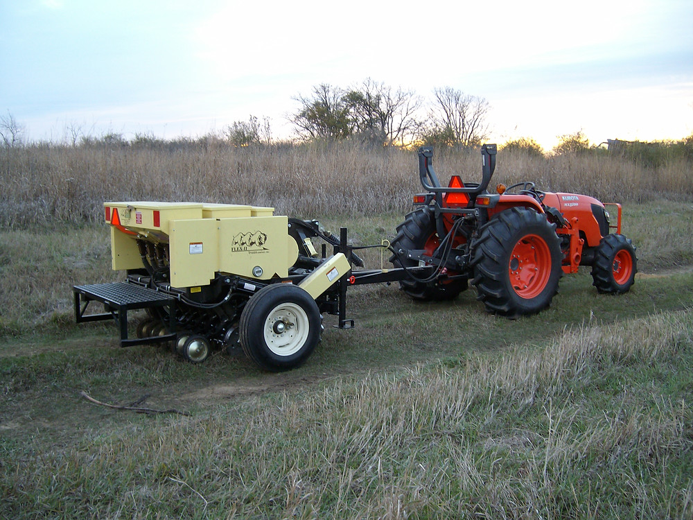Grass no-till drill with tractor