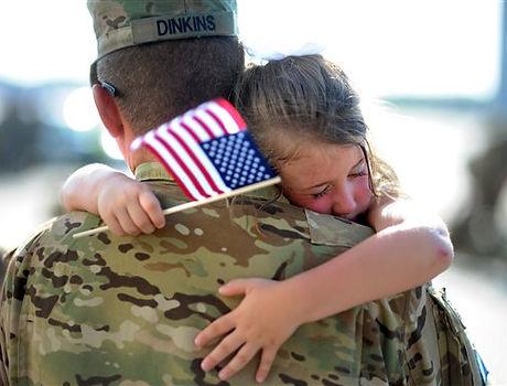 Soldier-holding-child.jpg