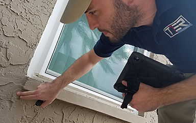 Tampa Home Inspector inspecting the exterior of a home