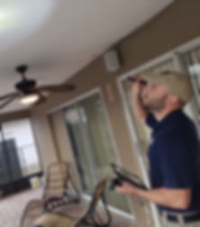 Tampa Home Inspector inspecting a covered lanai area
