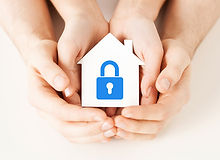 Hands safely holding a miniature model home symbolising home insurance and relevant to four point insurance surveys