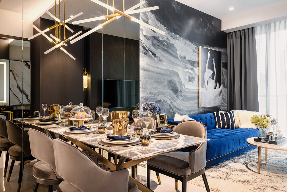 marina one residences mr shopper studio interior design renovation project royal blue velvet couch chandelier mirrored wall marble dining table dining room