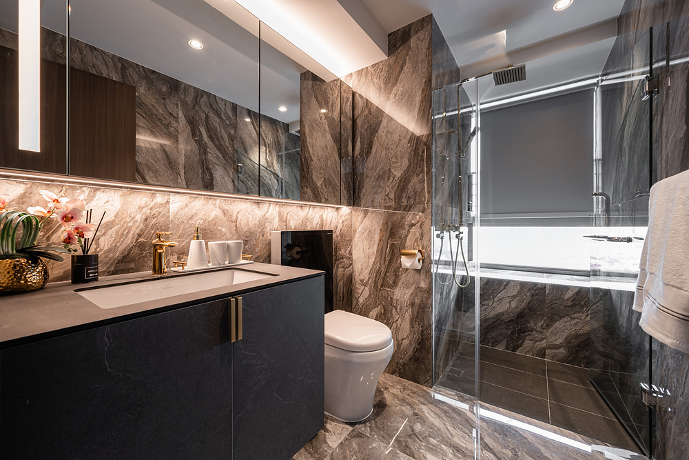 luxurious hotel bathroom city view home renovation project mr shopper studio singapore dark marble walls and gold metal fittings