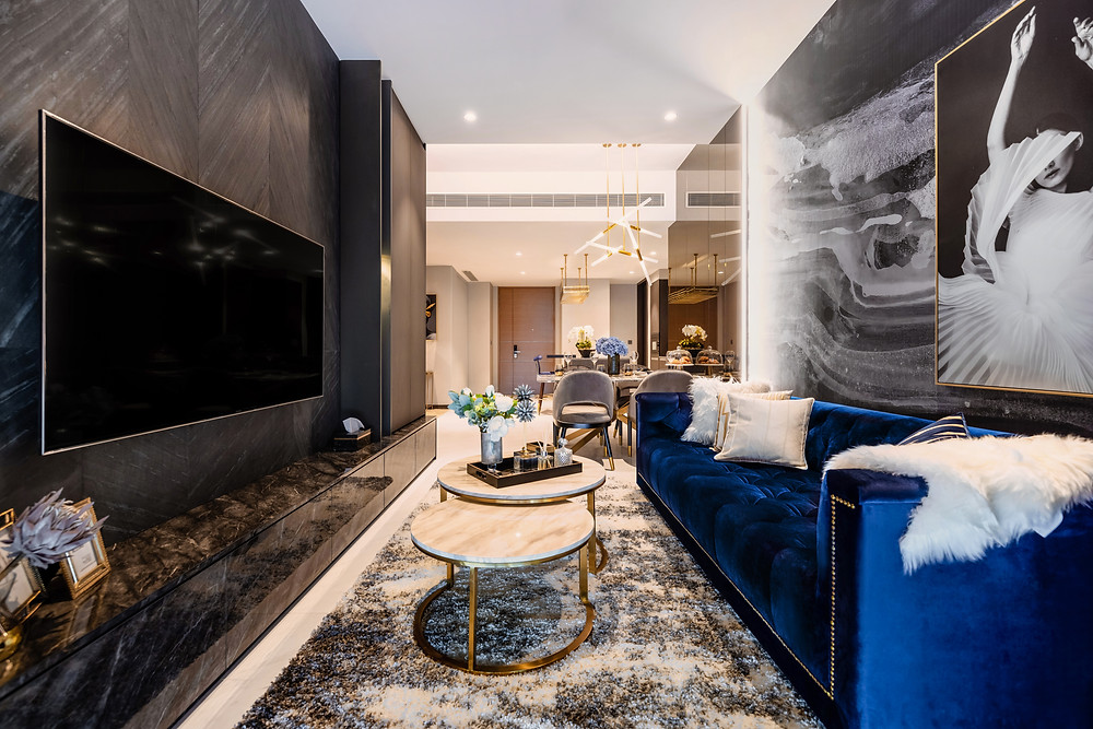 mr shopper studio boutique hotel concept modern luxury living room royal blue couch herringbone soft stone feature wall living room marina one residences