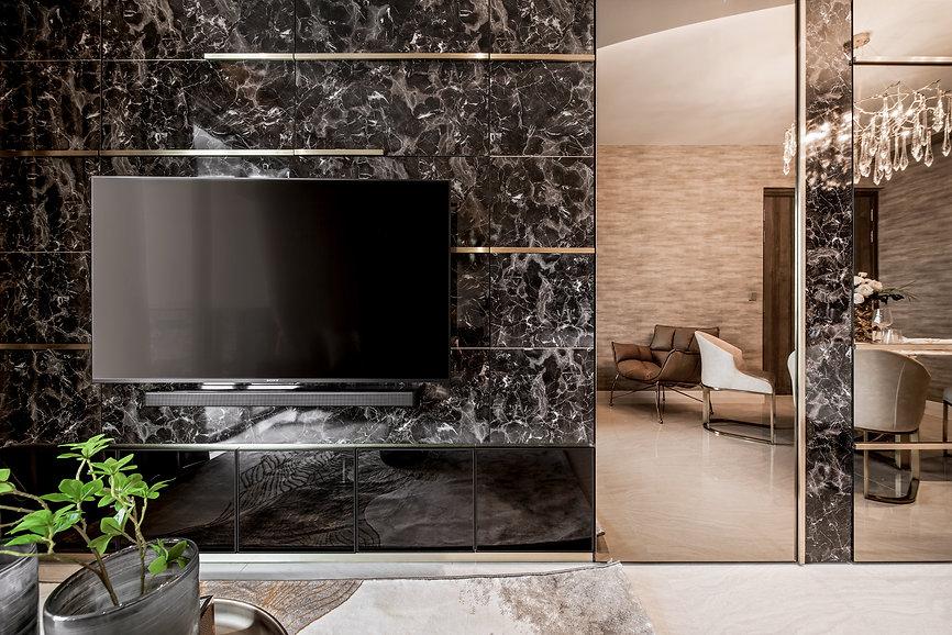 Stars of Kovan Tv living room wall feature marble laminate flush metallic details
