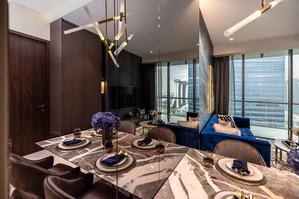 marina one residences mr shopper studio interior design home renovation project marble table against mirrored wall chevron pattern dining room overlooking living room